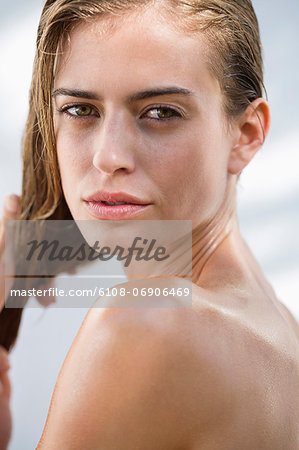 Portrait of a beautiful woman posing Stock Photo - Premium Royalty-Free, Image code: 6108-06906469