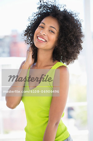 Portrait of a woman smiling Stock Photo - Premium Royalty-Free, Image code: 6108-06906496