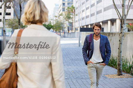 Man and woman walking on a street Stock Photo - Premium Royalty-Free, Image code: 6108-06906512