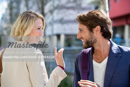 Man and woman smiling at each other Stock Photo - Premium Royalty-Free, Image code: 6108-06906538
