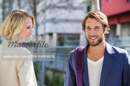 Close-up of a man and woman smiling Stock Photo - Premium Royalty-Free, Image code: 6108-06906576