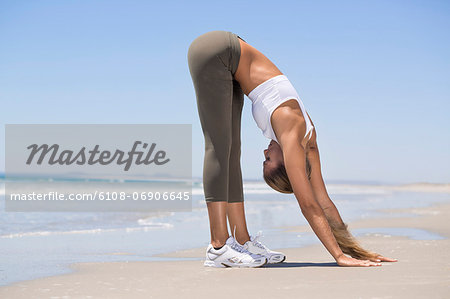 Woman exercising on the beach Stock Photo - Premium Royalty-Free, Image code: 6108-06906645