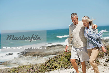 Couple walking on the beach Stock Photo - Premium Royalty-Free, Image code: 6108-06906860