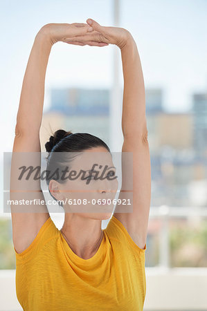 Close-up of a woman exercising in a gym Stock Photo - Premium Royalty-Free, Image code: 6108-06906921