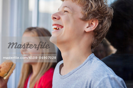Close-up of friends smiling Stock Photo - Premium Royalty-Free, Image code: 6108-06907028