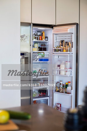Assorted food in a refrigerator Stock Photo - Premium Royalty-Free, Image code: 6108-06907069