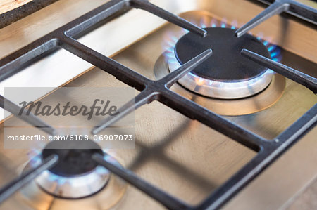 Close-up of a gas stove burner Stock Photo - Premium Royalty-Free, Image code: 6108-06907073