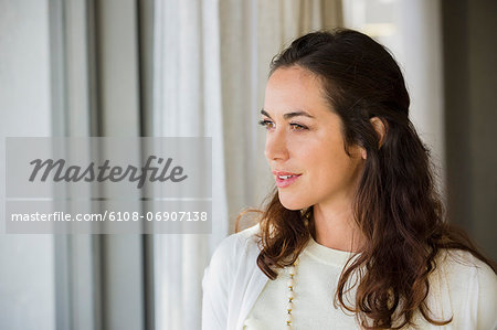Close-up of a woman smiling Stock Photo - Premium Royalty-Free, Image code: 6108-06907138
