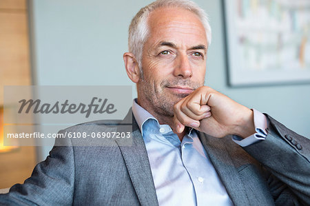 Close-up of a businessman thinking Stock Photo - Premium Royalty-Free, Image code: 6108-06907203