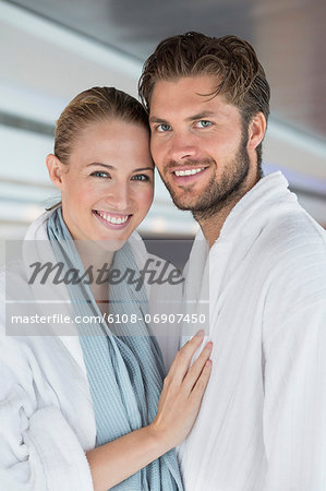 Portrait of a smiling couple in bathrobes at spa Stock Photo - Premium Royalty-Free, Image code: 6108-06907450