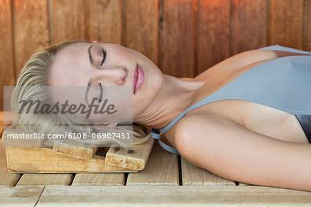 Close-up of a woman resting in a sauna Stock Photo - Premium Royalty-Free, Image code: 6108-06907451
