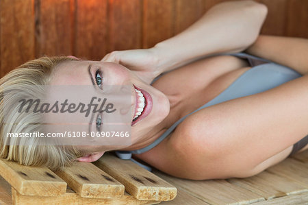 Portrait of a smiling woman relaxing in a sauna Stock Photo - Premium Royalty-Free, Image code: 6108-06907466
