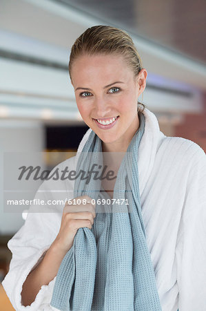 Portrait of a smiling woman in bathrobe at spa Stock Photo - Premium Royalty-Free, Image code: 6108-06907471