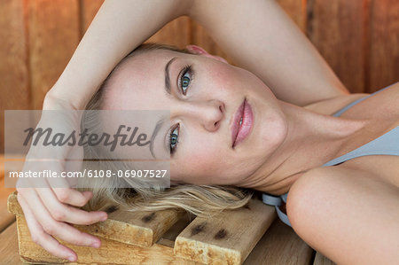Portrait of a woman resting in a sauna Stock Photo - Premium Royalty-Free, Image code: 6108-06907527