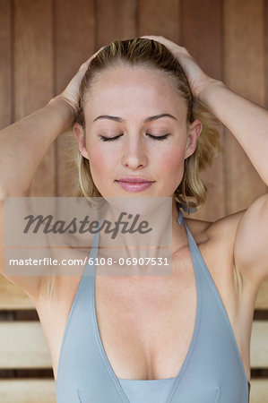 Close-up of a beautiful woman in a sauna Stock Photo - Premium Royalty-Free, Image code: 6108-06907531