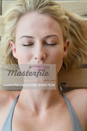 Close-up of a woman resting in a sauna Stock Photo - Premium Royalty-Free, Image code: 6108-06907534