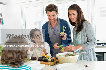 Family preparing food in the kitchen Stock Photo - Premium Royalty-Free, Image code: 6108-06907607