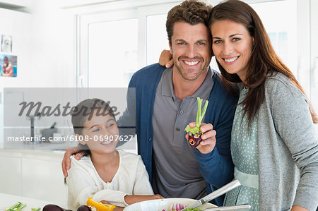 Couple with their daughter enjoying in the kitchen Stock Photo - Premium Royalty-Free, Image code: 6108-06907627