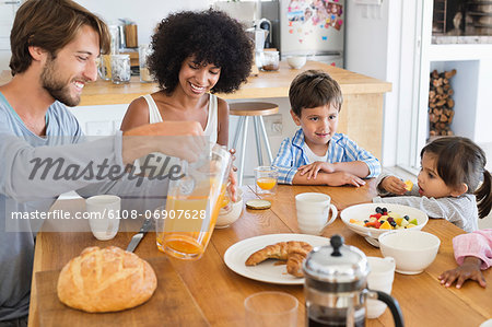 Family at breakfast table Stock Photo - Premium Royalty-Free, Image code: 6108-06907628