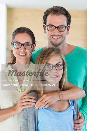 Portrait of a family wearing eyeglasses and smiling Stock Photo - Premium Royalty-Free, Image code: 6108-06907639