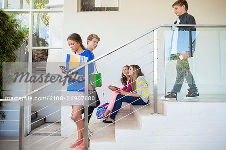 Students using electronic gadget in a school Stock Photo - Premium Royalty-Free, Image code: 6108-06907680