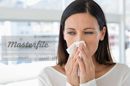Close-up of a woman sneezing Stock Photo - Premium Royalty-Free, Image code: 6108-06907760
