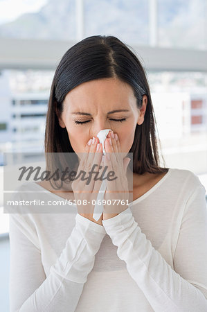 Close-up of a woman sneezing Stock Photo - Premium Royalty-Free, Image code: 6108-06907761