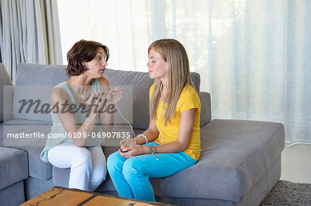 Woman talking to her daughter Stock Photo - Premium Royalty-Free, Image code: 6108-06907835