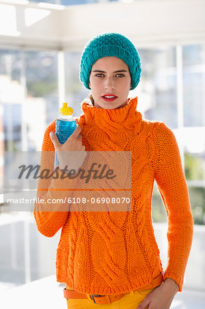 Portrait of a woman holding a water bottle Stock Photo - Premium Royalty-Free, Image code: 6108-06908070