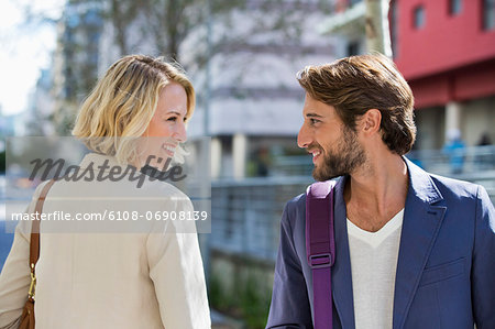Man and woman smiling at each other Stock Photo - Premium Royalty-Free, Image code: 6108-06908139