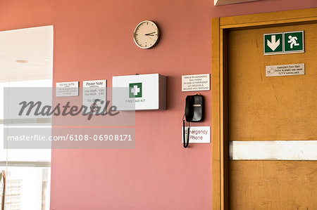 Emergency exit door with first aid kit and emergency phone Stock Photo - Premium Royalty-Free, Image code: 6108-06908171