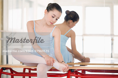 Girl stretching Stock Photo - Premium Royalty-Free, Image code: 6108-07969535