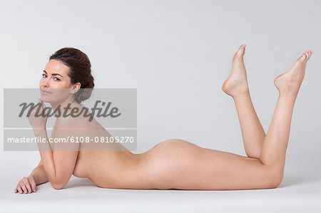 Woman lying in a spa Stock Photo - Premium Royalty-Free, Image code: 6108-08105270
