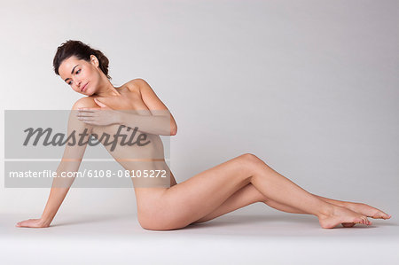 Woman sitting in a spa Stock Photo - Premium Royalty-Free, Image code: 6108-08105272
