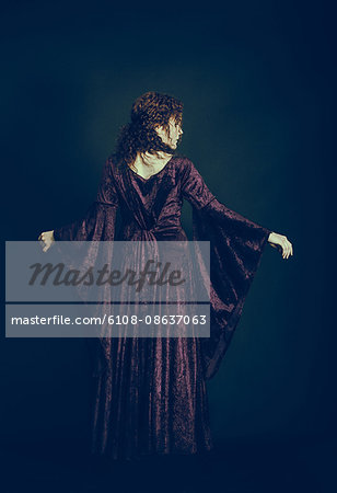 Woman in medieval dress Stock Photo - Premium Royalty-Free, Image code: 6108-08637063