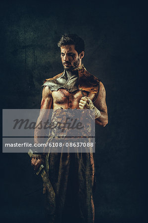 Tribal warrior standing clenched fist Stock Photo - Premium Royalty-Free, Image code: 6108-08637088