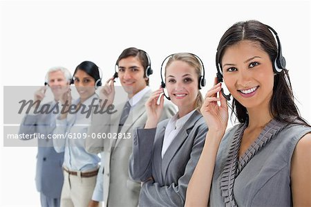 Call centre against white background Stock Photo - Premium Royalty-Free, Image code: 6109-06002813