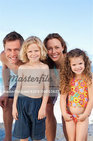 Happy young family spending their time on the beach Stock Photo - Premium Royalty-Free, Image code: 6109-06003627