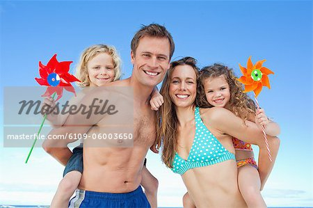 Playful young family enjoying their time together on the beach Stock Photo - Premium Royalty-Free, Image code: 6109-06003650