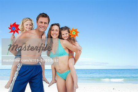 Jolly young family spending their time on the beach Stock Photo - Premium Royalty-Free, Image code: 6109-06003652