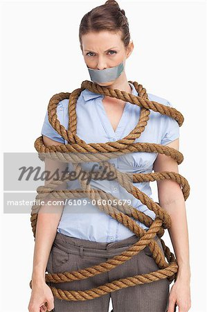 Tied up businesswoman against a white background Stock Photo - Premium Royalty-Free, Image code: 6109-06005679