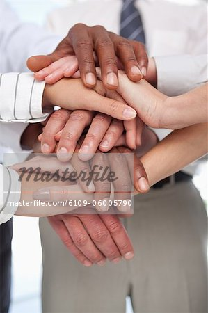 Several hands put together for teamwork gesture Stock Photo - Premium Royalty-Free, Image code: 6109-06005790