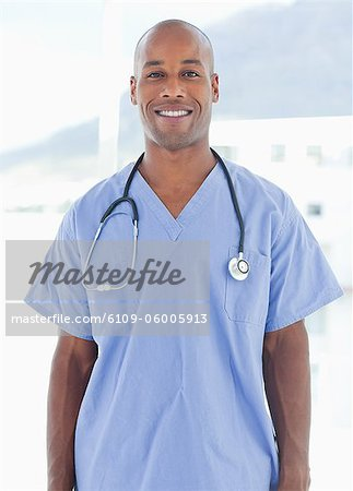 Smiling male doctor standing Stock Photo - Premium Royalty-Free, Image code: 6109-06005913