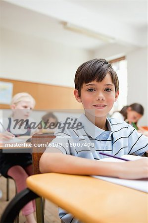 Elementary student sitting in class Stock Photo - Premium Royalty-Free, Image code: 6109-06007409