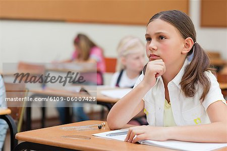 Primary student sitting at her desk Stock Photo - Premium Royalty-Free, Image code: 6109-06007423