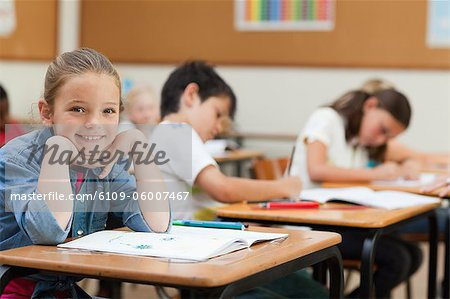 Side view of happy young schoolgirl during class Stock Photo - Premium Royalty-Free, Image code: 6109-06007467