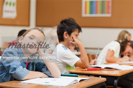 Side view of bored young schoolgirl Stock Photo - Premium Royalty-Free, Image code: 6109-06007470