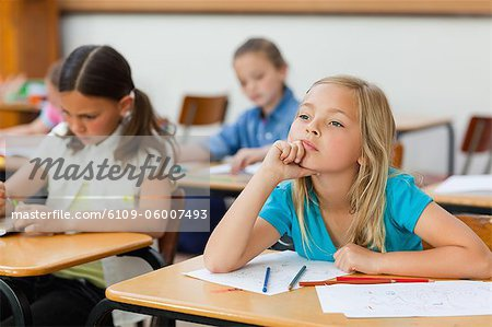 Little girl in class doesn't seem very focused Stock Photo - Premium Royalty-Free, Image code: 6109-06007493