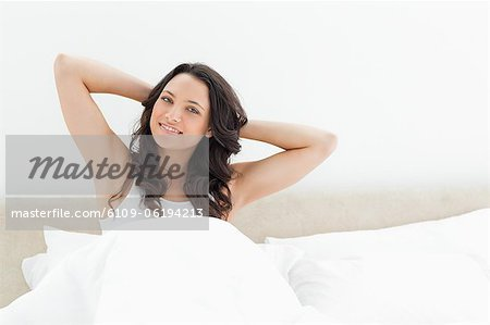 Attractive brunette waking up Stock Photo - Premium Royalty-Free, Image code: 6109-06194213