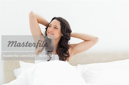 Cute brunette waking up Stock Photo - Premium Royalty-Free, Image code: 6109-06194214